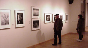 visitors in the gallery enjoy the Ansel Adams photos on exhibit
