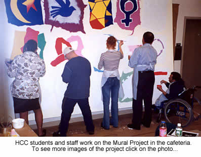 students and staff at work on the mural