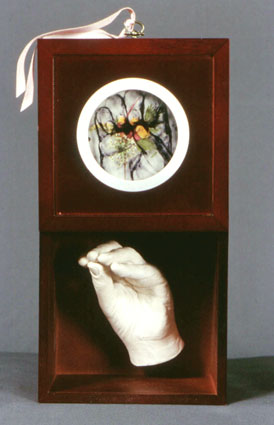 Artists' Hand: Grasp (open), FOR KEEP'S SAKE series, 2001, resin, wood, drawing/print on mylar, pressed flowers, 7 x 7 x 5 inches